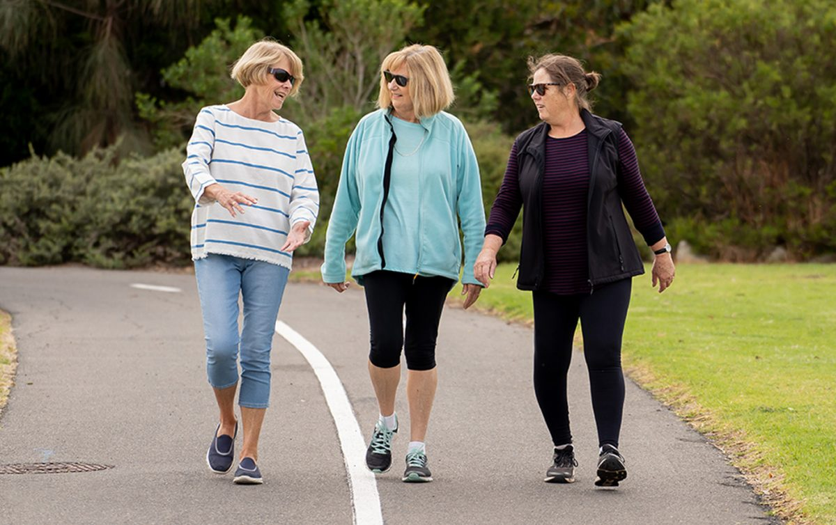 Three smiling women going for a walk