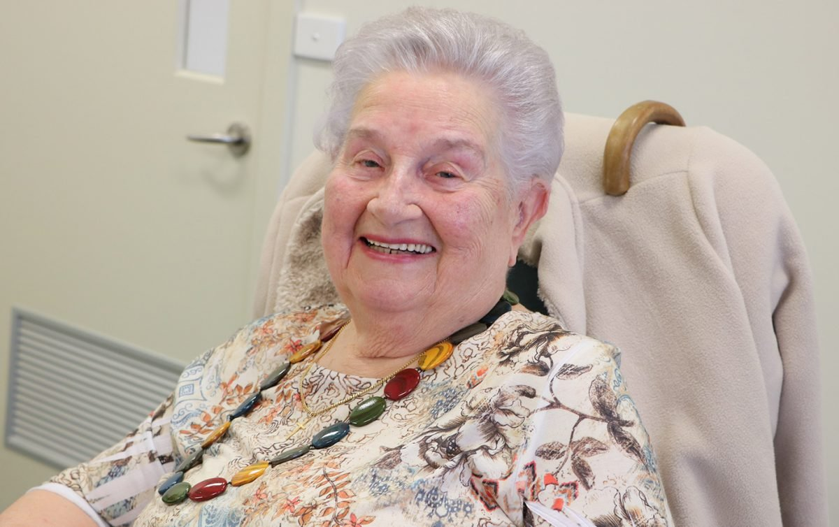 Ages care woman seated smiling