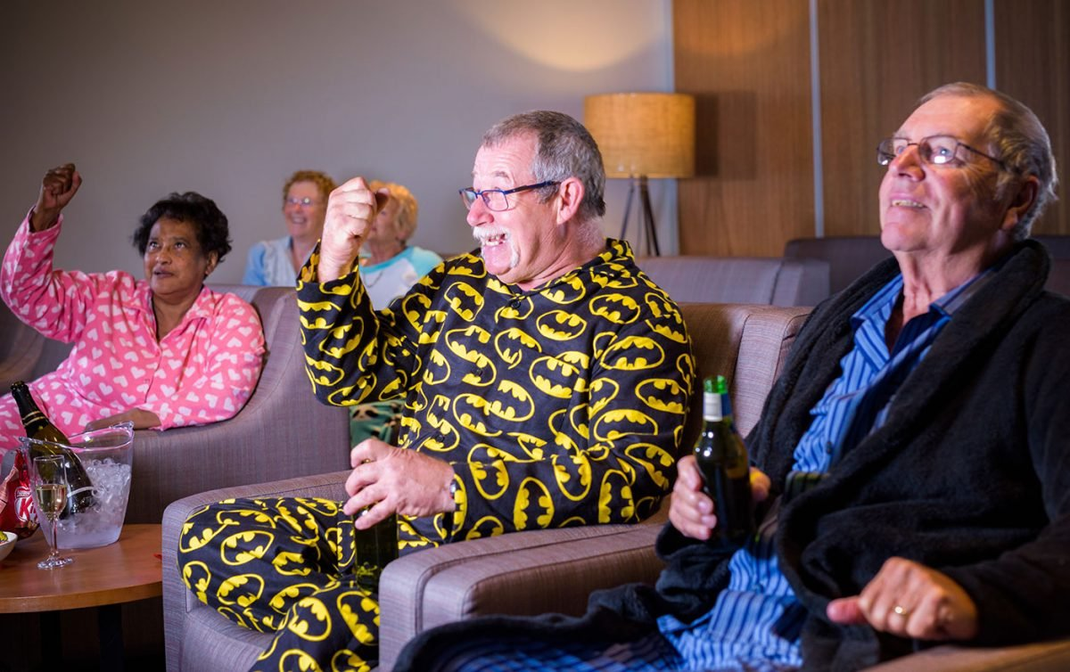 Aged care residents watching a movie