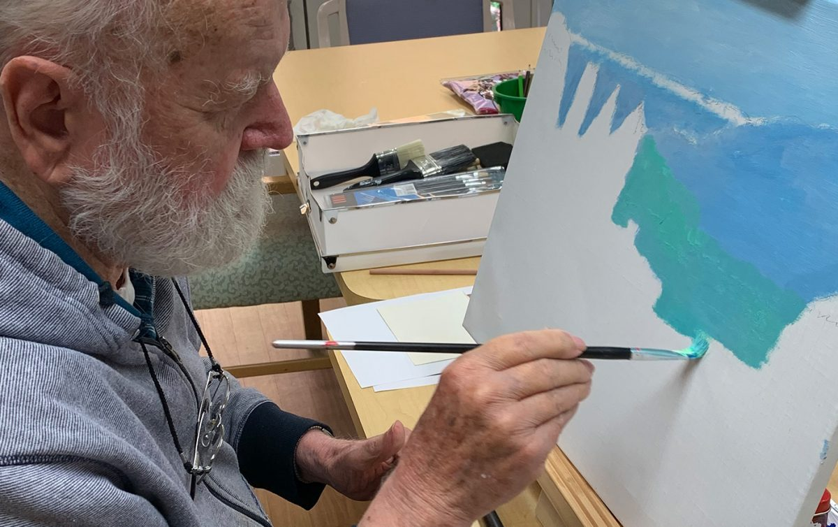 Aged care man painting at Costa House