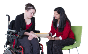 A support worker helping to explain something to a woman