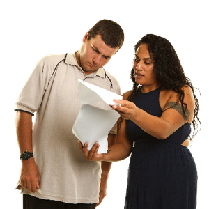 A support worker explaining paperwork to a man