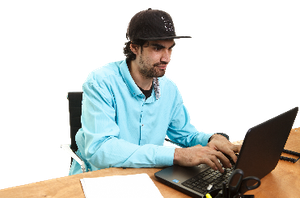 A man sitting and using a laptop