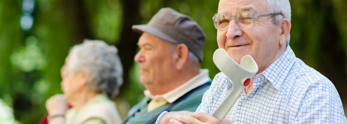 Aged care friends smiling in park